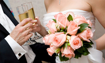 Image of a bride and groom holding champagne