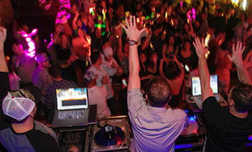 Photo from behind the DJ stand at a private party