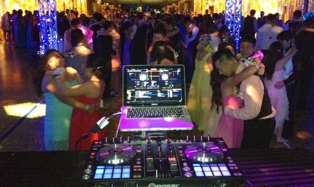 view of a school dance from behind the dj booth